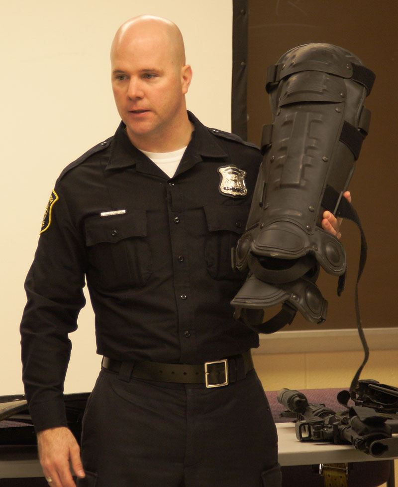 Officer holding tactical equipment